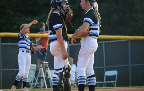 Junior catcher Ashley Sikes (left) and junior pitcher Lilli Backes (right) converse with each other during game one of their double header at Whitewater versus the Lady Wildcats. In an atypical performance from Starr's Mill, the Lady Panthers staggered and stumbled in a 2-0 sweep. The loss puts them out of the top four teams in the region, putting their postseason contention in jeopardy in what is a new low for Starr's Mill. Through the double header, Backes gave up 16 runs in an unusual performance from the star pitcher.