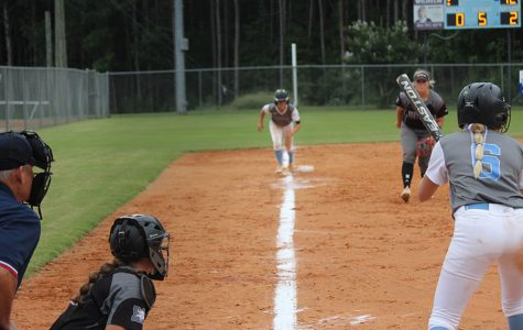 Senior Jolie Lester prepares for her at bat, while fellow senior Lauren Flanders looks to score from third. Strong hitting by Lester and 16 strikeouts from junior pitcher Lilli Backes helped the Lady Panthers even their region record at 4-4. The 3-0 win over Northgate moved Starr's Mill into fourth place in Region 2-AAAAA.