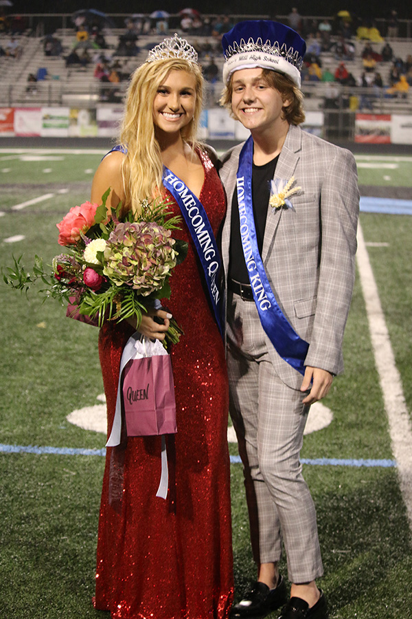 Homecoming king and queen, seniors Aiden Hammond and Jaci Edwards, pose for a photo after being crowned. This year's homecoming has certainly been different, but the senior class tried to make the most out of every moment.