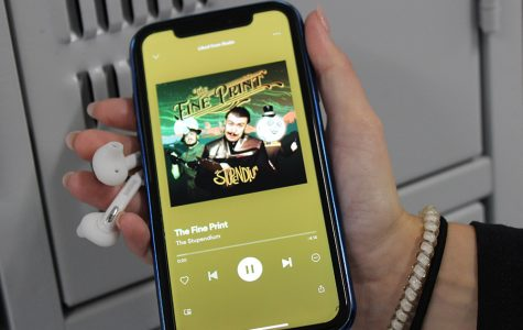 """Junior Spencer Jerome is listening to """"The Fine Prints"""" by The Stupendium. It has a funky beat while addressing real-world topics like capitalism and its influence on our lives."""
