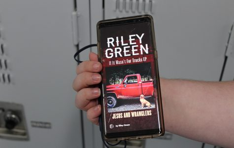 """Senior Bryson Daniel is listening to """"Jesus and Wranglers,"""" a song off of Riley Green's new album, """"If It Wasn't for Trucks."""""""