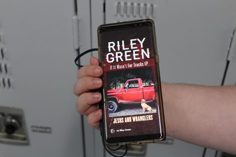 "Senior Bryson Daniel is listening to ""Jesus and Wranglers,"" a song off of Riley Green's new album, ""If It Wasn't for Trucks."""