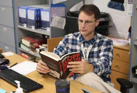 """Math teacher and varsity girls' soccer coach John Bowen is currently reading """"Range"""" by David Eipstein. The text makes an argument against overspecialization."""