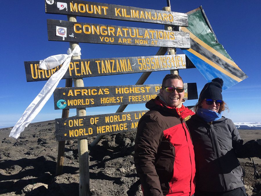 Starr's Mill alum Glenn Goorsky pictured with his high school sweetheart, Rachel Taylor, who is now his wife, at the top of Mt. Kilimanjaro. Goorsky, while successfully pursuing and implementing a football leadership program for the Panthers, continues his love of travel with his job.