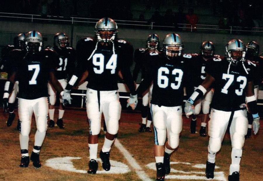 Glenn Goorsky (63) pictured with Antonio Brown (7), Bradley Connor (94), and Jeff Partlow (73) walk onto the football field prior to senior night in 2005. Goorsky was captain of the football team his senior year and has gone on to continue a strong leadership role in his career.