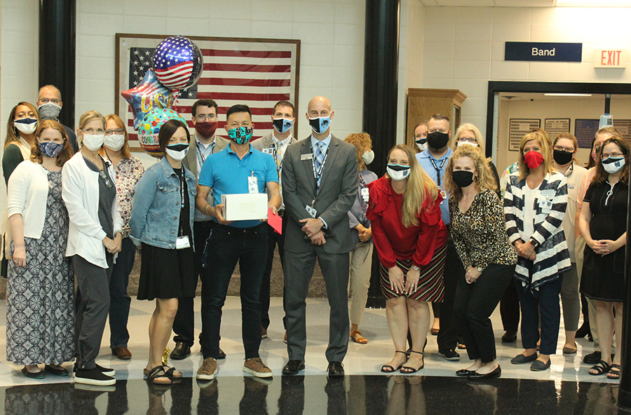 School custodian Hai Le pictured with fellow Starr's Mill staff as they celebrate his citizenship. Originally from Vietnam, Le officially became a United States citizen for the sake of his family.