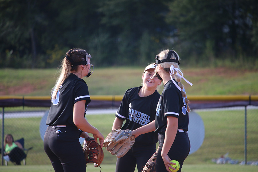 "Junior Lilli Backes and seniors Jolie Lester and Lauren Flanders meet in the circle. ""Our team has really come together,"" Lilli Backes said. ""They've really helped me out defensively, and we've had a lot of success."""