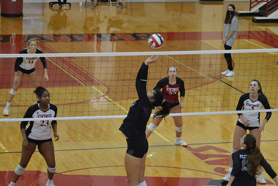 Senior Luna Wan sets the ball as freshman Rachel Reininger prepares for a hit. Wan led the team in nearly every statistical category.