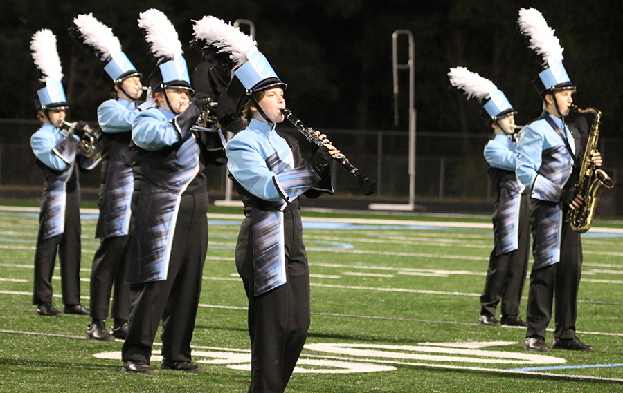 Starr's Mill High School performs at Friday night's football game vs. Griffin High School. The band is taking a unique approach to social distancing at this year's holiday performance.