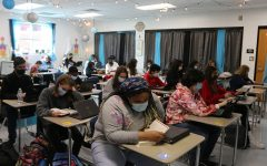 Students wearing face masks in Adriah Williams' seventh-period Food, Nutrition, and Wellness class. COVID-19 has been plastered all over the news since mid-March of 2020. The global pandemic's spread can be limited by wearing masks and social distancing, something posing a challenge to schools reopening for the 2020-2021 school year due to people's blatant disregard for the health and safety of others.