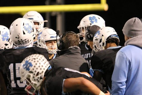 Head coach Chad Phillips talks with the offense during a timeout in the Panthers' second round playoff game against the Coffee Trojans. Starr's Mill ran with the Trojans for a while, but progressively lost control as the game went on, resulting in a 24-9 loss to eliminate Starr's Mill from the playoffs. Against Coffee, Starr's Mill set a season low for points scored and a season high for points allowed.