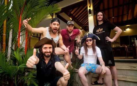 Alestorm band members (left to right), vocalist Cristopher Bowes, guitarist Máté Bodor, drummer Peter Alcorn, keyboardist Elliot Vernon, and bassist Gareth Murdock, pose for a photo. With the rising popularity of sea shanties, I recommend this song for those that are hankering for some more cool music of this nature.