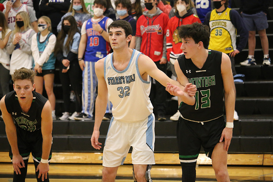 "Senior Brandon Allison guards senior Evan Gilliarders. ""A lot of out scoring comes from our starting five, but a lot of stellar defense comes from the bench,"" head coach Josh Reeves said. ""We're a team that tries to be balanced."""