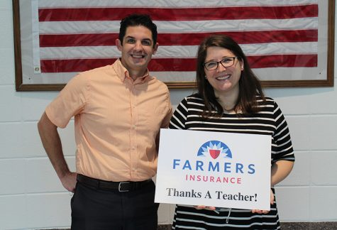 Timothy Monihan poses with this month's Golden Apple award winner, math teacher and girls basketball coach Emily Sweeney. The standout factor to Sweeney's teaching is how she goes about her interactions with students.