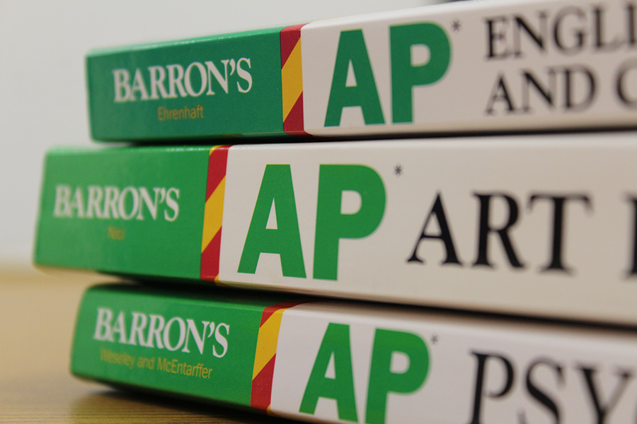 In previous years, students would complete an application and a work sample in order to be considered for Advanced Placement courses. However, AP courses across the county are now open enrollment, but they still require a minimum grade.