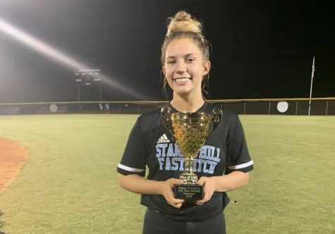 Junior Ashley Sikes poses with the 2020 Region 2-AAAAA championship trophy. While being known for her long-running softball passion, her heart lies with giving back to a more healthful community.