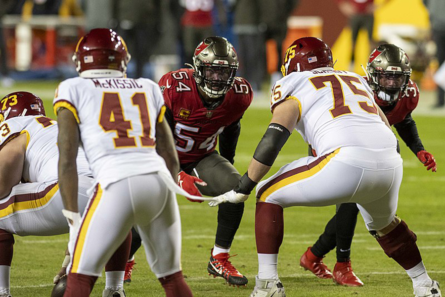 Tampa Bay Buccaneers linebacker Lavonte David waits for the upcoming snap during the team's 31-23 wild card game win against the Washington Football Team at FedEx Field on Jan. 9. Last night, David and the Buccaneers successfully shut down the Kansas City Chiefs and their offense to win Super Bowl LV, 31-9. Kansas City did not score a single touchdown throughout the Super Bowl, the first time the team did not score a touchdown in a game since quarterback Patrick Mahomes took control under center. On top of six tackles, David helped contain Chiefs tight end Travis Kelce, limiting Kansas City's most productive receiver to 10 receptions and 133 yards.
