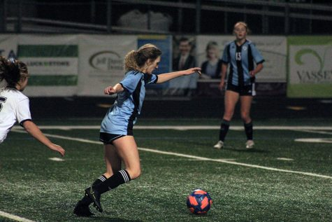 Senior midfielder Darby Olive moves the ball downfield during the girls varsity soccer game on Tuesday against the Marist. The Lady Panthers tied in a difficult game against Marist, 0-0.