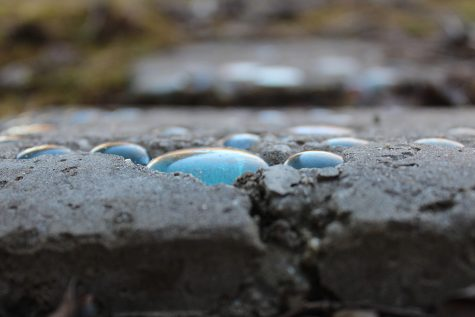 Jan. 15, 2021 - Cerulean marbles cemented in stone slab in the courtyard between the 600 and 700 hallways.