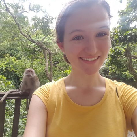 "Alumnae Morgan Knowlton, class of 2016, pictured in Indonesia with a monkey in the background. Knowlton graduates from Georgia Tech this year and has been honored as the sole representative of Georgia Tech to represent the system's ""highest scholastic ideals."""