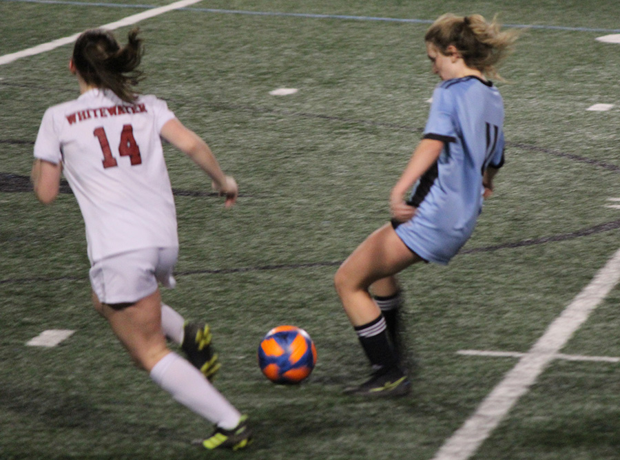 Senior midfielder Darby Olive dribbles the ball downfield. The Lady Panthers capitalized on their newfound momentum to dominate Whitewater on both sides of the ball. Five different players scored either a goal or an assist. Olive scored a goal off of an assist from senior Chloe Thompson with 10 minutes to go in the first half.