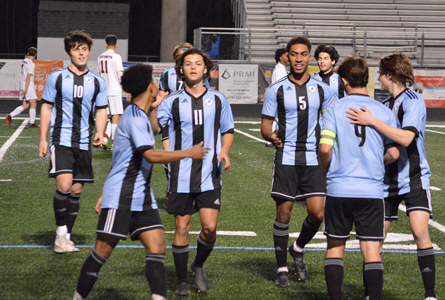 """The Starr's Mill boys soccer team celebrates with senior captain Brooklyn Muccillo following a goal during their game against the Whitewater Wildcats. Both soccer teams defeated Whitewater convincingly, the girls winning 6-2 and the boys winning 8-1. Muccillo scored four goals against Whitewater. """"It all stems in training,"""" Muccillo said. """"We know that we're not doing the stuff off the field for no reason, and then when we do what we do, it translates into that game and it works out."""""""