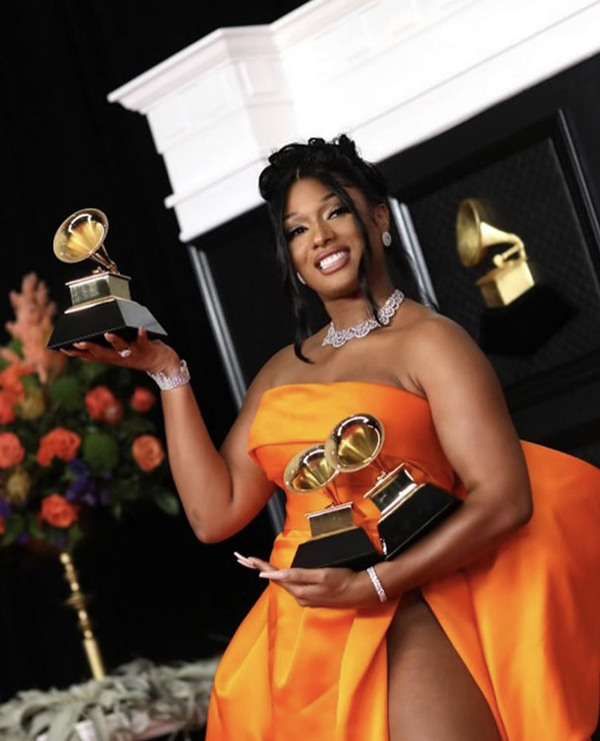 Megan+Thee+Stallion+poses+with+her+three+Grammys+for+Best+New+Artist%2C+Best+Rap+Performance%2C+and+Best+Rap+Song.+The+63rd+annual+Grammy+awards+show+featured+countless+talented+performers+along+with+many+artists+who+made+history.+