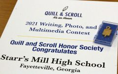 Quill and Scroll is an international organization that acknowledges high school scholastic journalists. Starr's Mill students Emily Davis, Abby Carter, and Rachel Laposka won Sweepstakes first place, third place, and an honorable mention, respectively.
