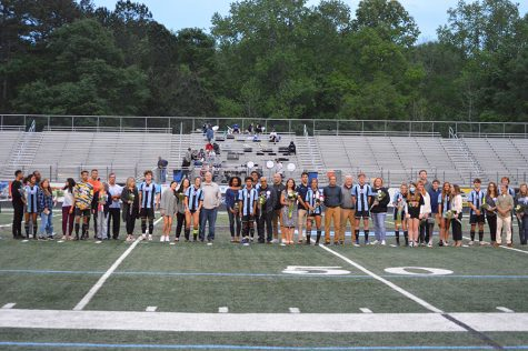 Seniors across both soccer teams pose for photos alongside their families between their games on senior night. Both teams honored their seniors for their contributions to Starr's Mill soccer over their high school years. The girls team struggled against a quick and aggressive Harrison team and lost 3-0. On the flipside, the boys thrashed Hampton, mercying them 10-0.
