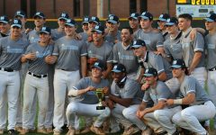 Starr's Mill baseball team poses with the region 2-AAAAA trophy following their game against the McIntosh Chiefs. The Panthers only needed one win against either McIntosh or Northside-Columbus to claim the region title, and they achieved their goal against the Chiefs. This is the program's fourth consecutive region championship and eleventh in school history.