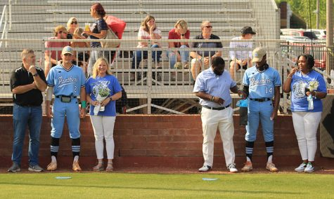 Seniors pitcher Eli Jones (left) and outfielder Thad Ector (right) stand alongside their families during the baseball team's season walk prior to their Tuesday game against the Whitewater Wildcats. After 11 seniors were honored by the team, the Panthers went straight to work against Whitewater. Despite a messy fifth inning, Starr's Mill played well and defeated the Wildcats 4-3. Both Jones and Ector will play baseball at the University of South Carolina next year.