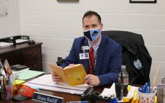 """Assistant principal and athletic director Shane Ratliff has read """"Energy Bus"""" by Jon Gordon. The book reveals 10 rules for leading a better life."""