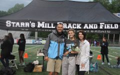 """Allie Walker poses with her parents on senior night. She will attend and run for Georgia Tech. """"I started running at a young age and I feel in love with it,"""" Walker said. """"It is a stress reliever for me. I just enjoy it and I have met so many good people."""""""