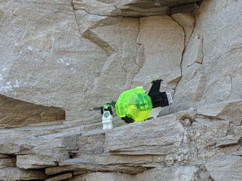 Blacktron spaceman prepares for adventure on rocky planet