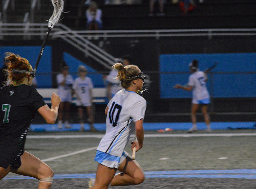 Senior Jacqueline Broderick evades a McIntosh defender and carries the ball up the field into the attacking zone. Broderick forced five of McIntosh's 20 turnovers as Starr's Mill defeated the Chiefs 7-3 for the area championship.