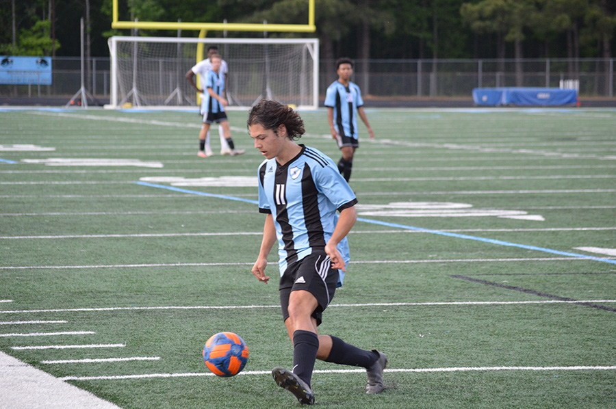 Sophomore Camilo Velez goes to kick the ball. Velez scored two goals, both within the first 10 minutes of the game.