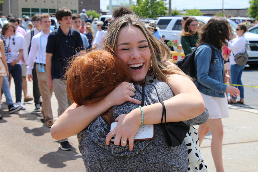 May 20, 2021 - Senior Emily Stackhouse hugs sophomore Andie Whitlock as the seniors say their final goodbye to Starr's Mill during Senior Walk.