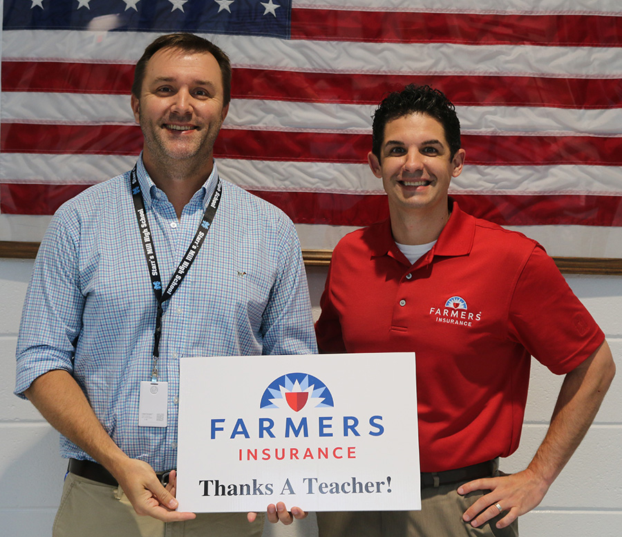 This month's Golden Apple recipient J.B Campbell with Farmers Insurance sponsor Tim Monahan. Campbell was chosen for his ability to challenge students.