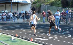"""Senior sprinter and anchor leg Will Knowlton crosses the finish line at the end of the boys 4x400 meter relay. The track team competed last Saturday in the Sectional B meet, which consisted of regions 2, 3, 6, and 7, sending 21 entrants from Starr's Mill to state. One of those entries was the boys 4x400 relay team, who won their event with a time of 3 minutes and 21.29 seconds. """"A lot of momentum going in [to sectionals], so today we wanted to keep up that mentality,"""" Knowlton said. """"Just continue to do what we've been practicing. [Sectionals] is just a show of how we've practiced. We do practice perfectly, at high standards, so we knew it was going to replicate out on the field so we just wanted to do it how we practice."""""""