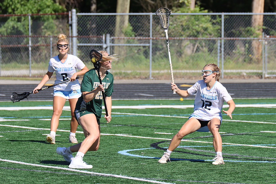 Senior Lauren Flanders locks off a Wesleyan attacker in the state quarterfinals. Flanders tallied one goal, three caused turnovers, and two draw controls. The Panthers won 16-10 and advances to the GHSA A-AAAAA semifinals for the third straight year.