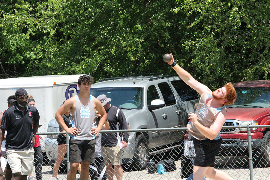 Senior Berry signee Joseph Rampey (right) slings a shot put ball in the shot put finals as sophomore Josh Phifer (left) watches. Three throwers, sophomore Josh Phifer, junior Darrien Doster, and Rampey, threw in shot put for the Panthers. Only Rampey was able to qualify for the state with a distance of 49 feet and 5 inches. Rampey will head to Berry after high school to play football and throw.