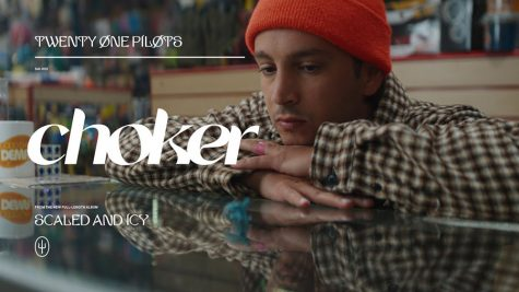 "Screenshot from Twenty One Pilots' music video for ""Choker,"" featuring frontman Tyler Joseph and drummer Josh Dun. Released on April 21, ""Choker,"" features distinct influences from their first two albums ""Self-Titled"" and ""Regional At Best."" Along with these influences, ""Choker"" continues Twenty One Pilots' reputation of breaking away from mainstream norms in the music industry."