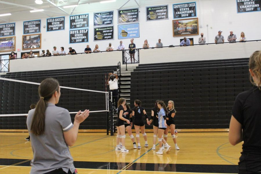 JV volleyball head coach Shayne Thompson looks on as the team celebrates a point against Fayette County. The Lady Panthers cruised to victory over the Lady Tigers 25-6, 25-4, but could not overcome mid-game deficits versus East Coweta losing 25-19, 25-18.