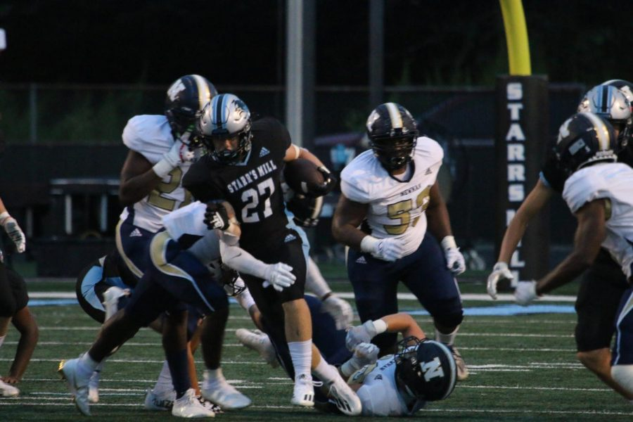 Junior running back Jacob Free attempts to avoid a tackle from the Newnan defense. Free rushed four times for 75 yards and scored in the third quarter on a 53-yard run. Starr's Mill rushed 44 times for 365 yards in the team's 28-14 over the Cougars to begin the season.
