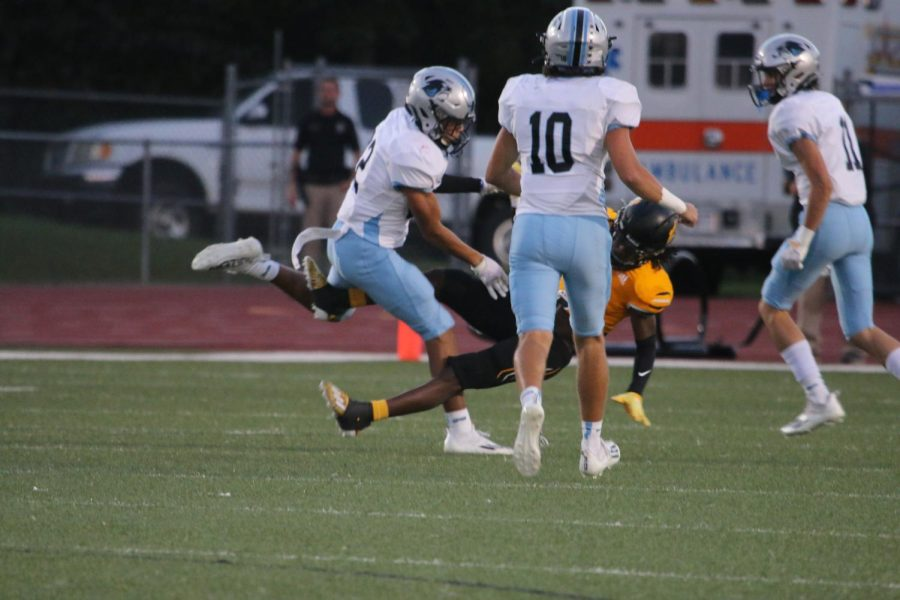 Senior Marc Stampley tackles as senior Colin Bartek and sophomore Bo Walker run to assist. In the first half, the Panther defensive team successfully stopped Harris County's offense from scoring. Meanwhile, Starr's Mill's offense kept driving the ball and finished the half leading 21-0.