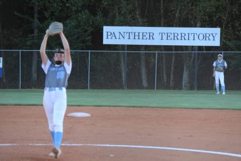 Senior pitcher Lili Backes prepares to throw a pitch as senior outfielder Sydney Blair watches. The Lady Panthers swept Jackson County 7-0, 5-2 in round two of the GHSA state playoffs.