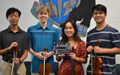 """Quartet Le Petit members pose with the Franklin Pond Chamber Music Competition School Prize. The quartet also earned second place overall for performing Beethovens """"String Quartet No. 4 Op. 18."""""""