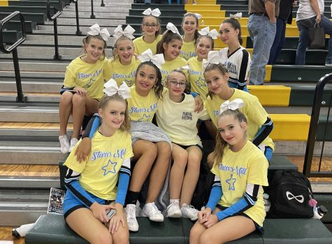 JV cheer gathers after competing at Ola High School. The team placed second behind Greenbrier.