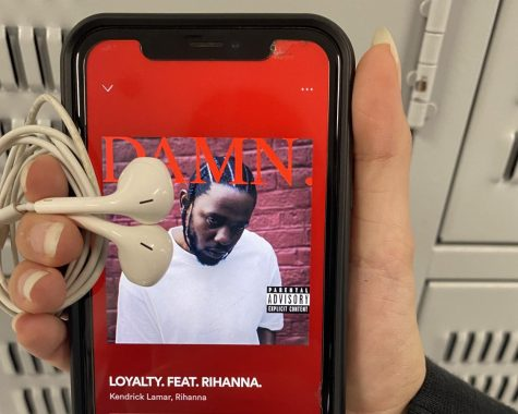"""Freshman Hayden Pittman is listening to """"Loyalty"""" by Kendrick Lamar. Kendrick Lamar is an American rap artist born in Compton, California, whose lyrics have been influenced by Tupac Shakur, Notorious B.I.GEminem, Jay Z, and Nas."""