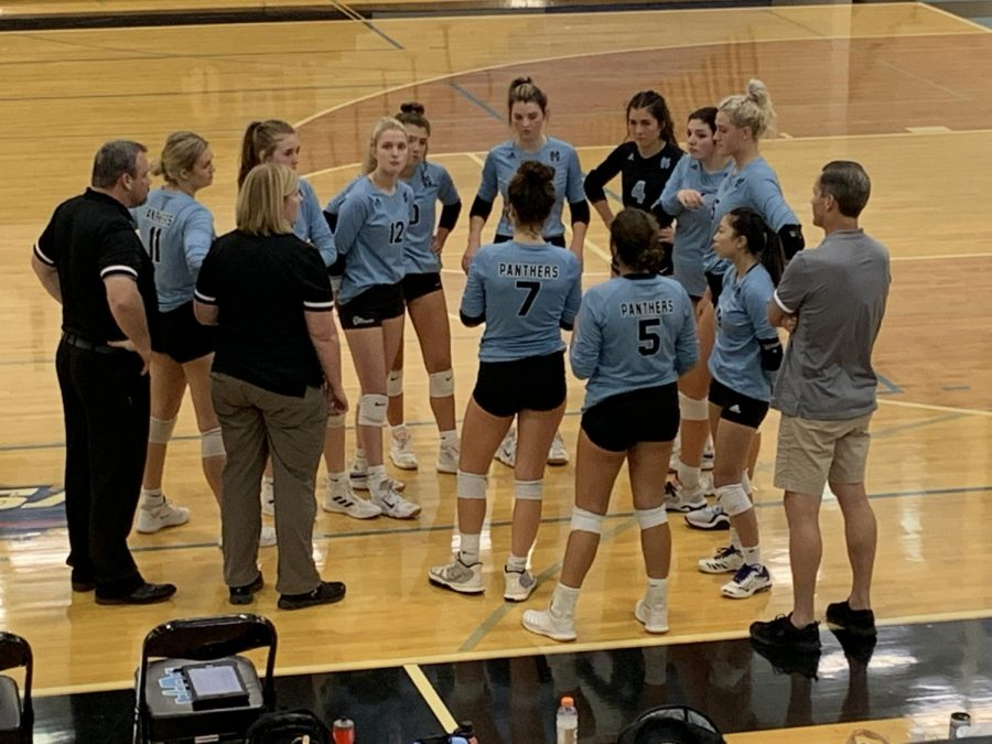 Volleyball head coach Jason Flowers calls a timeout in the second set against Harris County. Starr's Mill lost to Harris County 2-0, eliminating the Lady Panthers from the region tournament and ending their season.